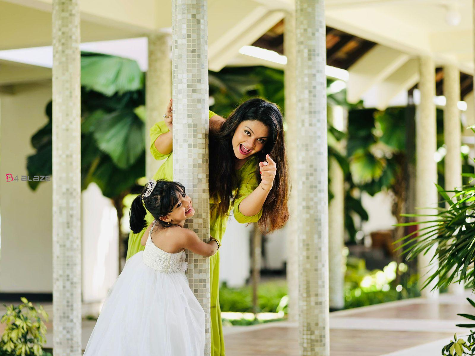 Shilpa Bala playing with her daughter
